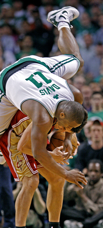 Celtics forward Glen Davis sails over the back of Cavaliers guard Wally Szczerbiak trying to make a play.