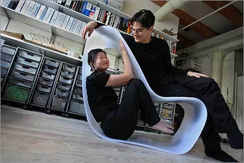 J. Meejin Yoon & Eric Howeler, a husband and wife architectural and design team, lounged on their Loop Chair in their living and work space in Boston. They've designed several celebrities' living or studio spaces in the area and in New York.