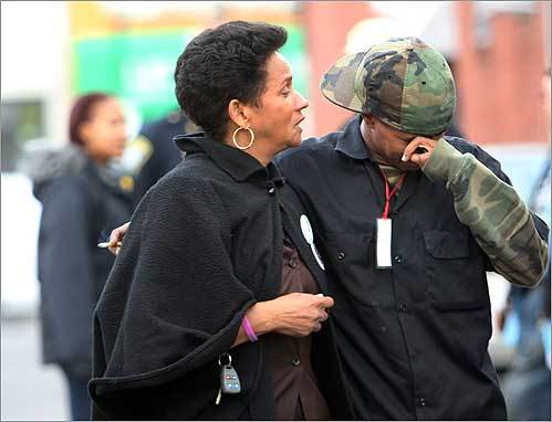 Isuara Mendes comforted a friend of her late son Saturday at a peace vigil. Mendes, who has lost two sons to violence, was among those who gathered at the Third Annual Peace Community Peace Vigil held on Wendover Street in Roxbury.
