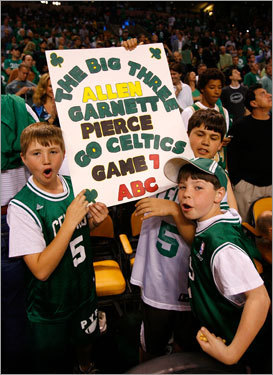 Fans hold up a sign of support for the Celtics' new 'Big Three' at the Garden before Sunday's Game 7.