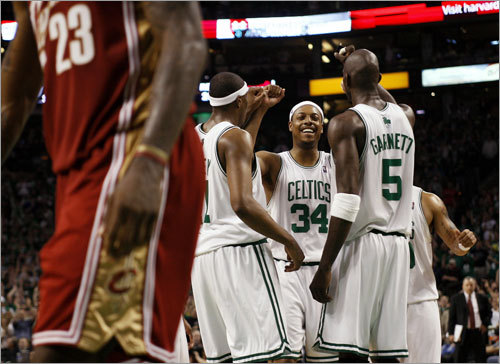 Pierce (34) was congratulated by teammates Kevin Garnett (5) and James Posey after barely making a free throw in the final minute of the game. LeBron James is at left.