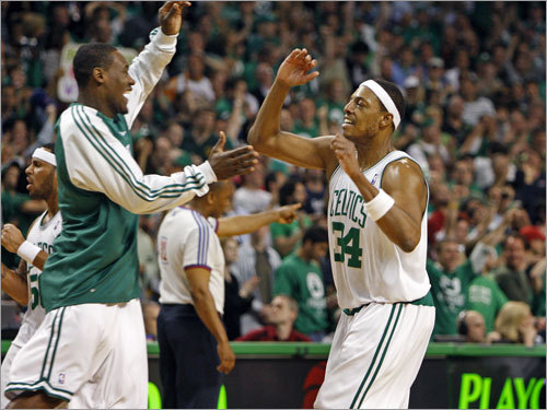 Celtics captain Paul Pierce (34) gets a high-5 from teammate Tony Allen after a big play late in the game.