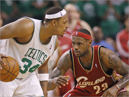 Celtics captain Paul Pierce (34) works against Cleveland's LeBron James.