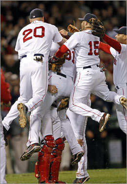 Lester and Varitek were mobbed by teammates running out of the dugout as the speakers played 'Tessie.'