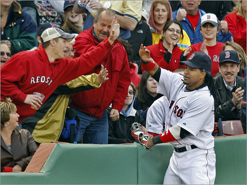 Manny Ramirez high-fived a fan after making a catch in left field. Is this a new tradition?
