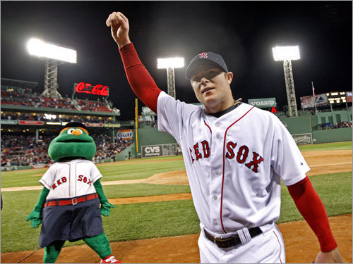 Wally the Green Monster reveled in the incredible night as Lester saluted the crowd on his way to the clubhouse.