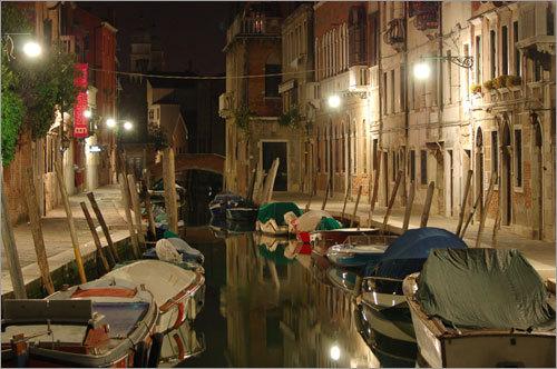 An illuminated canal.