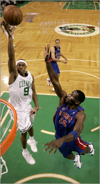 Rondo (11 points, 7 assists) soared toward the hoop, opposed by Detroit's Antonio McDyess.
