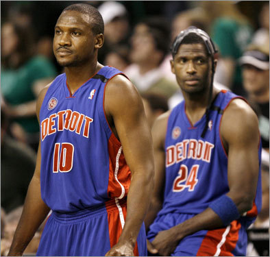 Pistons Lindsey Hunter and Antonio McDyess (background) were resigned to the game's result.