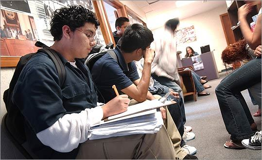 Omar Orellana, 14, fills out an application for a summer job at the Chelsea Collaborative. The agency is in danger of losing a private $75,000 grant.