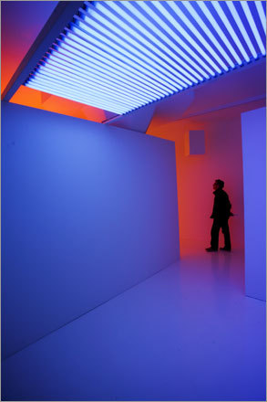 A visitor navigates colors of 'Chromosaturation Reykjavík' by Carlos Cruz-Diez at the Reykjavík Art Museum.