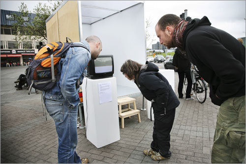 Passersby take a look at 'Module,' a mobile exhibition space that moved around Reykjavík.