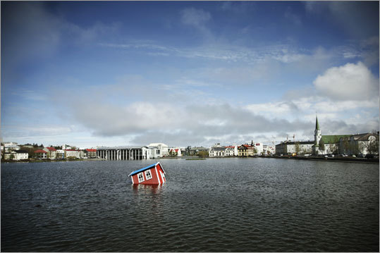 Icelander Halldor Ulfarsson and Finn artist Tea Makipaa collaborated on 'Atlantis,' the sunken house in the Reykjavik pond.