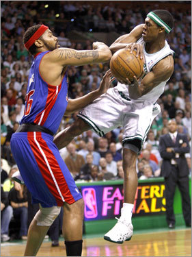 Rajon Rondo, who finished with 13 assists, ran into the Pistons' Rasheed Wallace while trying to dish off in the first quarter.