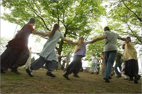 Members of the 12 Tribes of Israel group danced to the rhythms of Israeli music during the Earthfest Celebration along Storrow Drive by the Hatch Memorial Shell in Boston.
