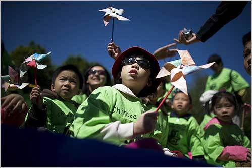 Hannah Lieu held the windmill she colored as she and other Chinese Church Head Start children waited before the start of the Annual ABCD (Action for Boston Community Development, Inc.) Head Start Parade. More than 3,000 children, parents, and staff marched on Boston Common.
