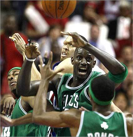 Boston Celtics forward Paul Pierce (left), forward Kevin Garnett , and guard Rajon Rondo battled for a 1st quarter rebound during Game 4 against the Piston in Auburn Hills, Mich.