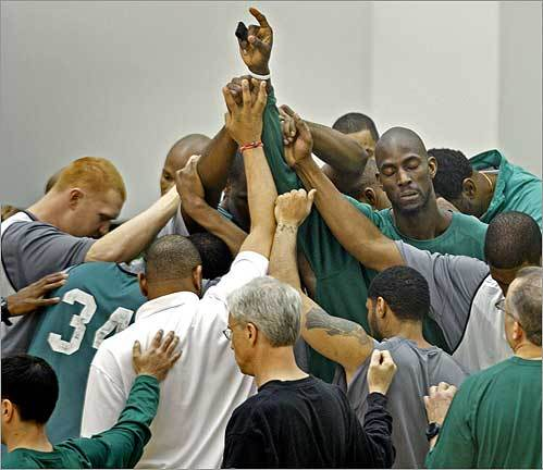 The Celtics gathered for a moment of togetherness as practice ended in Waltham.