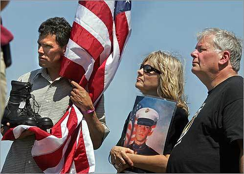 A Memorial Day peace rally was held at Christopher Columbus Park in Boston's North End with Veterans for Peace, Iraq Vets Against the War, and Gold Star Families for Peace. Carlos Arredondo of Boston, an immigrant from Costa Rica, held a boot representing his son Alexander, who died fighting in Iraq. Joyce Lucey of Belchertown, accompanied by her husband, Kevin, held a portraint of their son Jeffrey, who committed suicide after serving in Iraq.