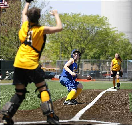 East Boston High's Mckenzie Powers was run back and forth between third and home -- she settled on third and was safe. A moment later, she stole home. The girls' softball team from East Boston lost, 11-3, to Latin Academy in the City Women's Softball Championship on Memorial Day at Charlestown High School.