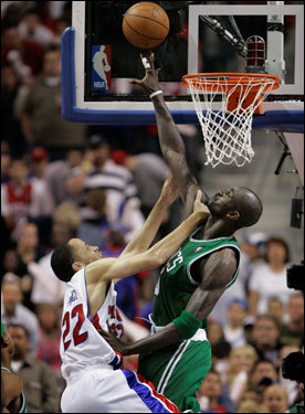 Celtics forward Kevin Garnett (right) challenged a shot from Pistons forward Tayshaun Prince (left) in the first quarter.