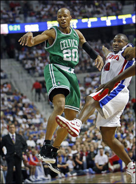 Pistons guard Lindsey Hunter (right) and the Celtics Ray Allen were airborne as Allen got off a quick pass in the first half.