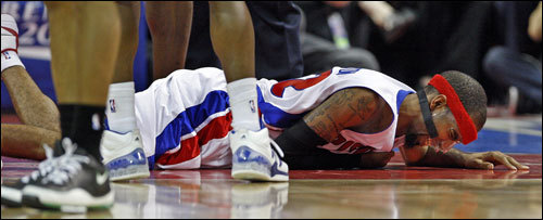 Detroit Pistons Guard Richard Hamilton winced in pain on the floor in the first half.