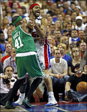 Celtics forward James Posey (right) was tied up with Rasheed Wallace in the first half.
