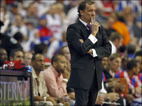 Pistons coach Flip Saunders looked on during play.