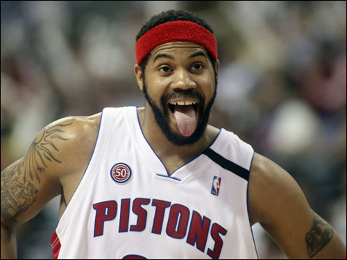 Detroit Pistons forward Rasheed Wallace sticks his tongue out during a break in the first half.
