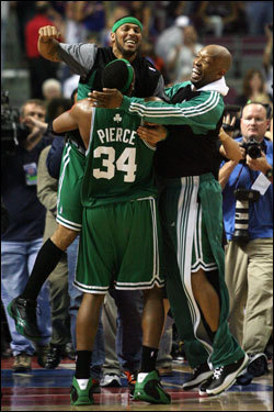 Paul Pierce (34), Eddie House (left), and Sam Cassell (right) celebrated Boston's Game 6 victory over the Detroit Pistons.
