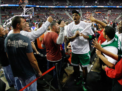 Paul Pierce celebrated in front of some Celtics fans.