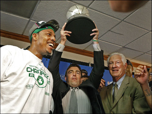 Paul Pierce (left), Wyc Grousbeck (center), and John Havlicek (right) celebrated after the game.