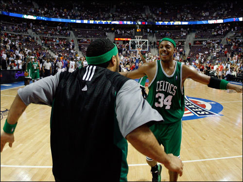 Celtics reserve Eddie House (left) celebrated with Paul Pierce (right) after the game.