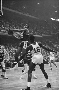 Game 7, 1962 -- The rivalry begins A nip-and-tuck game goes to overtime after the Lakers' Frank Selvy (not pictured) misses a baseline jumper at the buzzer. The Celtics respond in the extra frame and pull off the victory, 110-107. Bill Russell is the star of the show for the Green with 30 points and an astonishing 40 rebounds. In this photo, Elgin Baylor (left) and Tom Sanders battle it out.