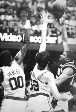 Game 4, 1987 -- Magic's 'junior, junior, junior skyhook' The Lakers are down 106-105 on their final possession of the game, but Magic Johnson (right) defies a triple-team from Larry Bird, Kevin McHale, and Robert Parish by floating a hook shot over The Chief and into the net. Bird gets one last shot to steal the win for the Celtics, but the ball rims out at the buzzer. Los Angeles goes on to win the series and its fourth title of the decade.