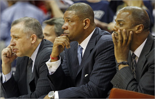 Celtics head coach Doc Rivers (center) and assistants Tom Thibodeau (left) and Armond Hill (right) watch the action during the playoffs.