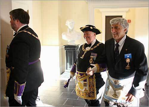 (L-R) Mason W. Russell, Deputy Grand Master and Roger W. Pageau, Grand Master, both of the Grand Lodge of Massachusetts, are joined by Eugene A. Capobianco, Past Master of St. John Lodge. Gene is conducting a procession as part of a ritual to commemorate the 275th anniversary of St. John Lodge in Boston, the oldest Freemason group in the United States.