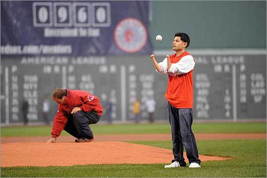 Javier Serrano of Somerville tossed a baseball in the air before throwing a ceremonial first pitch during Wednesday night's Red Sox game at Fenway Park.