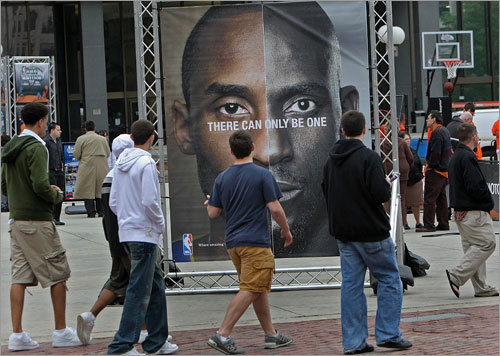 Fans check out a display next to a mobile basketball playground and other activities centered around the NBA Finals on Boston City Hall Plaza.