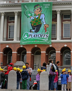 A Celtics banner hung in the front of the Massachusetts State House with some ducklings walking past on a tour from the Claypit Hill Elementary School in Wayland.
