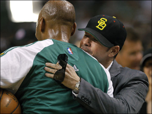 Actor and Celtics fan Donnie Wahlberg (right) hugged Sam Cassell before the game.