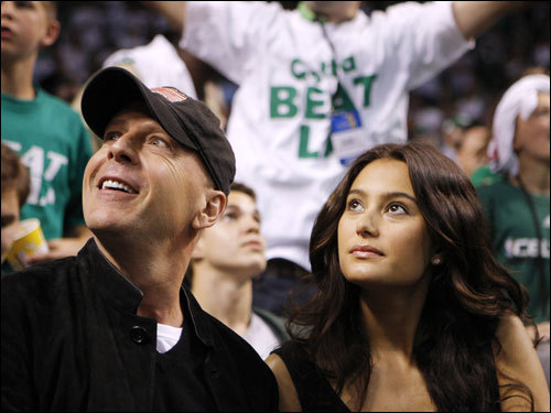 Actor Bruce Willis (left) and his date were in the crowd before the game.