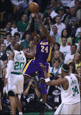 Lakers guard Kobe Bryant (right) took a jump shot over Ray Allen in the first half.