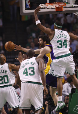 Celtics defenders including Paul Pierce (34) shifted their defense to stop the Lakers drive in the first half.