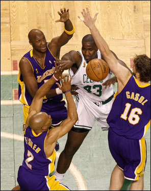 Laker defenders swarmed Celtics center Kendrick Perkins (43) under the basket in the first quarter