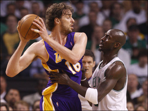 Celtics forward Kevin Garnett (right) squared off against Pau Gasol (left) during first half action.