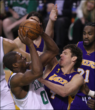 Celtics forward Leon Powe (left) took a shot during the first half.