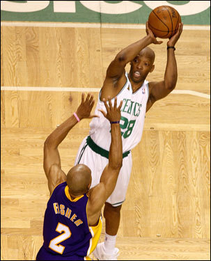 Celtics point guard Sam Cassell shot over Derek Fisher during first half action.