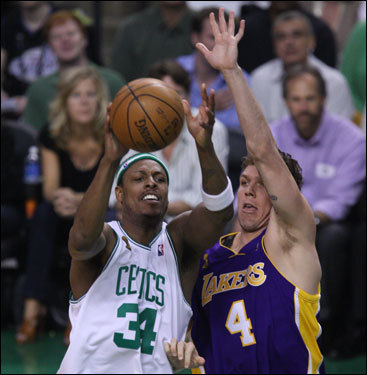 Paul Pierce (left) shot over Lakers forward Luke Walton (right) during the game.
